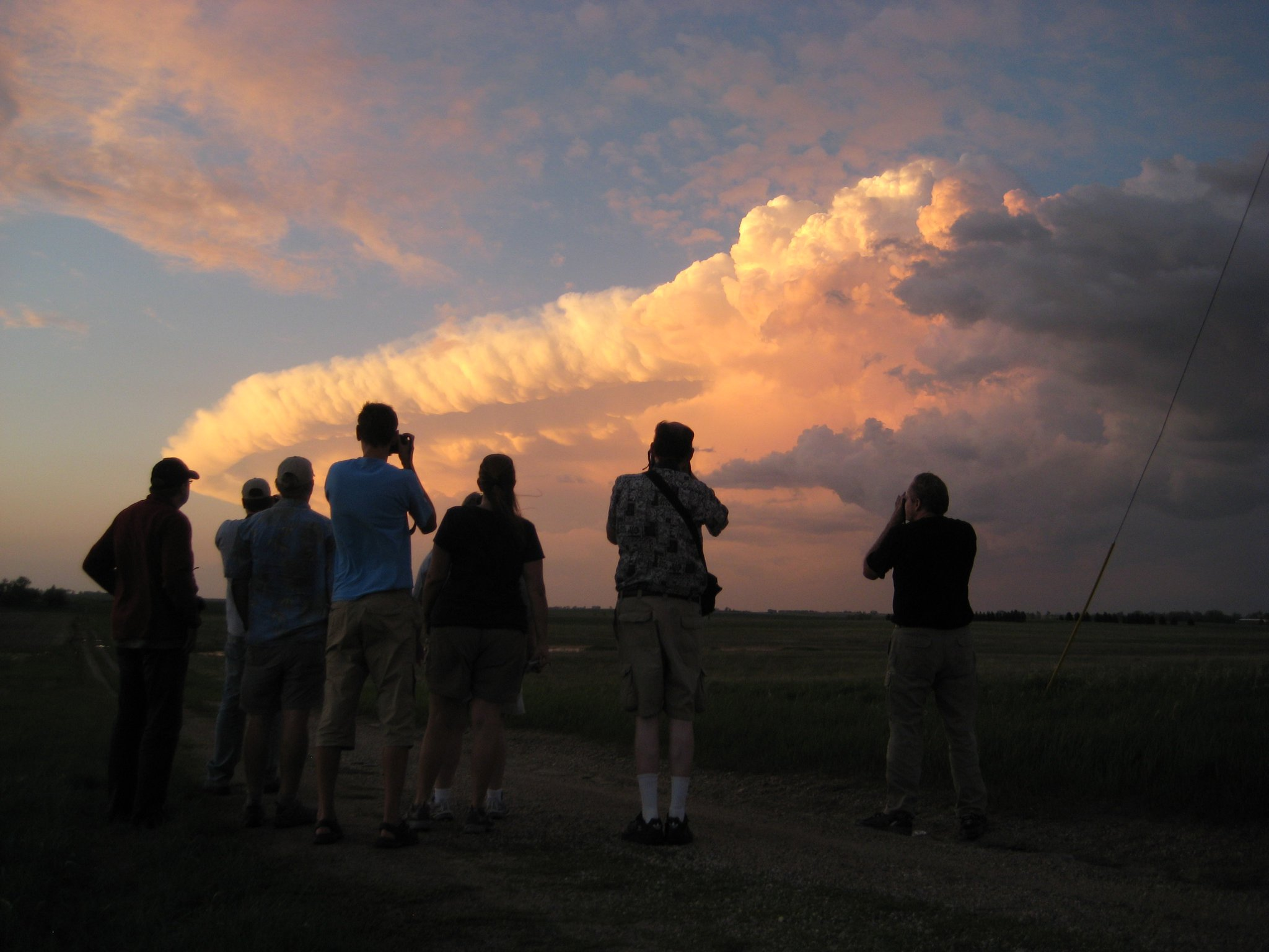 Storm chasing tour guests observe a supercell near Minot, ND